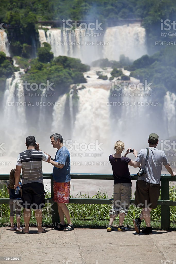 Group of tourists taking photos at Iguacu Waterfalls in Brazil royalty-free stock photo