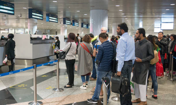 MALAYSIA - MAR 21, 2017: Group of travelers enter immigration control at Kuala Lumpur International Airport (KLIA) in Malaysia. stock photo