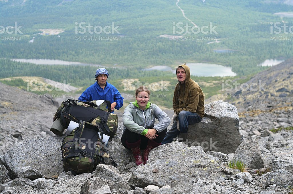 Group of travelers in mountains with knapsacks royalty-free stock photo