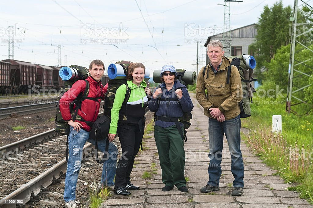Group of travelers on railway station waiting a train. royalty-free stock photo