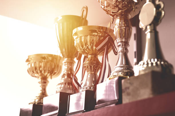 Group of Trophies on Shelf stock photo