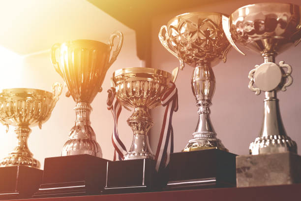 Group of Trophies on Shelf Group of trophies on shelf. trophy award stock pictures, royalty-free photos & images