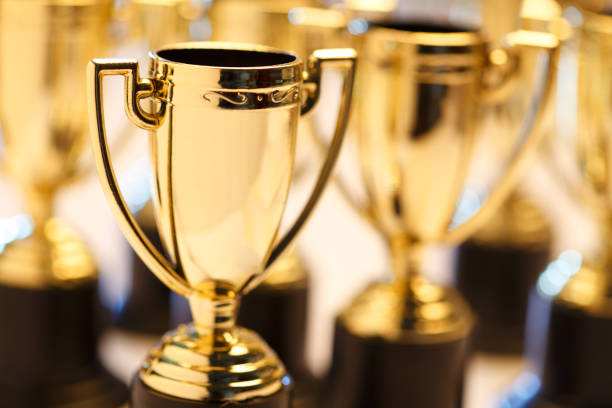 Group Of Trophies A group of trophies photograped with a very shallow depth of field. trophy award stock pictures, royalty-free photos & images