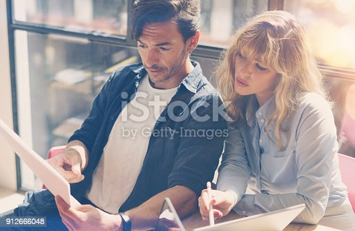 912675036 istock photo Group of two businessmans at working process.Young professionals work with new market project. Project managers meeting room.Blurred background.Horizontal.Flares. 912666048