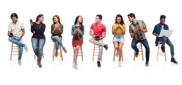 Group of university classmates using technology A horizontal photo of millennial university students sitting together and each using an electronic device. stool stock pictures, royalty-free photos & images