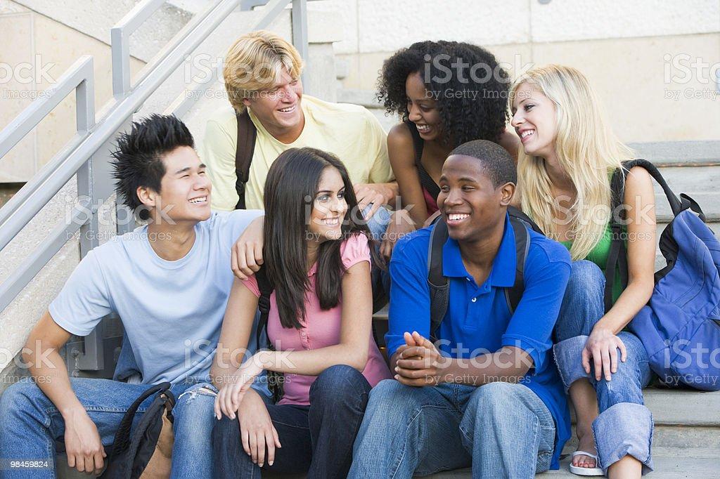 Group of university students sitting on steps royalty-free stock photo