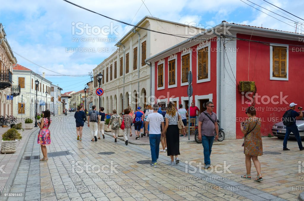 Group of unknown tourists is on street (Rruga G'juhadol) in center of Shkoder, Albania stock photo