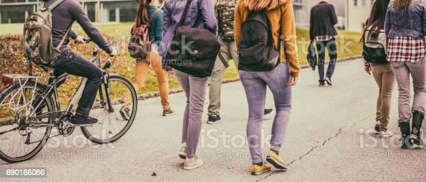 Group of unrecognizable sudents walking through the park picture id690166086?b=1&k=6&m=690166086&s=612x612&h=o5db8unq0gsohwvjwswaf8gbid4nrqnwprwbauoifne=
