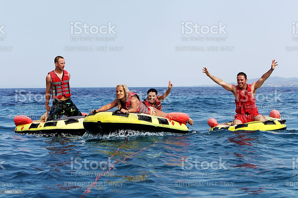 Group of unrecognized people doing water sport, in Halkidiki stock photo