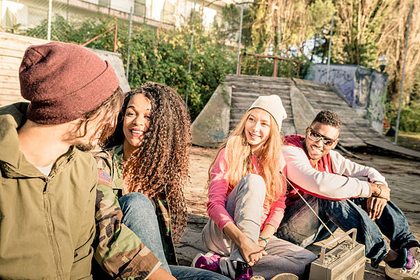 group of urban multiracial friends having fun time listening music - radio kultur stock-fotos und bilder