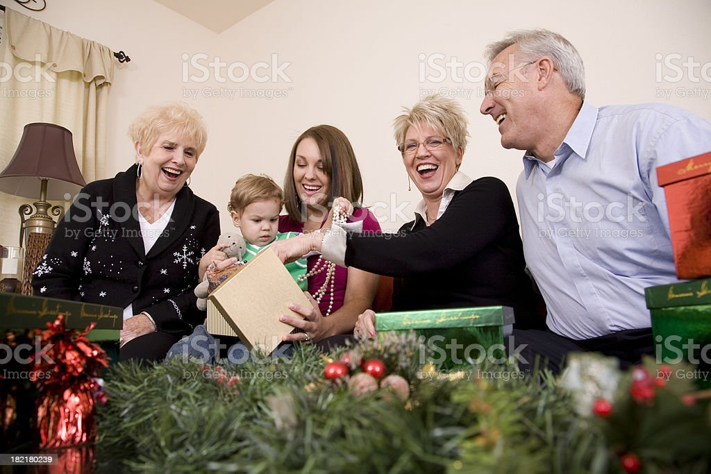 Group of various aged pear with holiday presents royalty-free stock photo