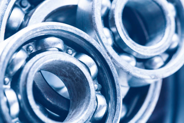 Group of various ball bearings as a background. Close up image with selective focus. Machinery background. stock photo