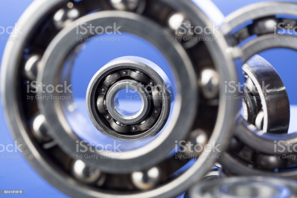 Group of various ball bearings close up on nice blue background. stock photo