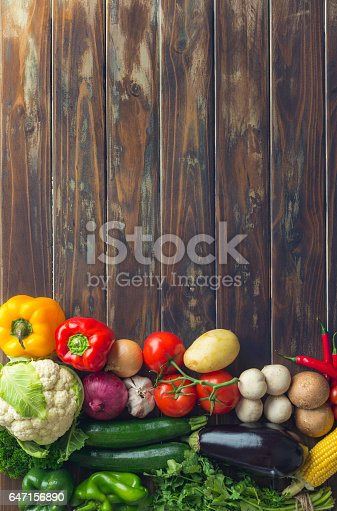 istock Group of vegetables on a wood background. 647156890