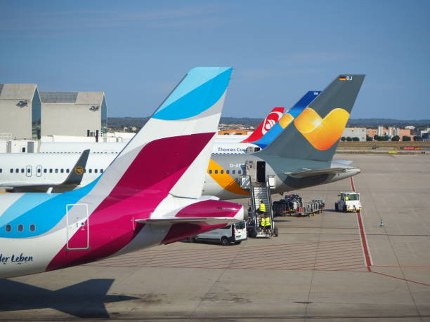 Group of vertical stabilizers of different airlines stock photo
