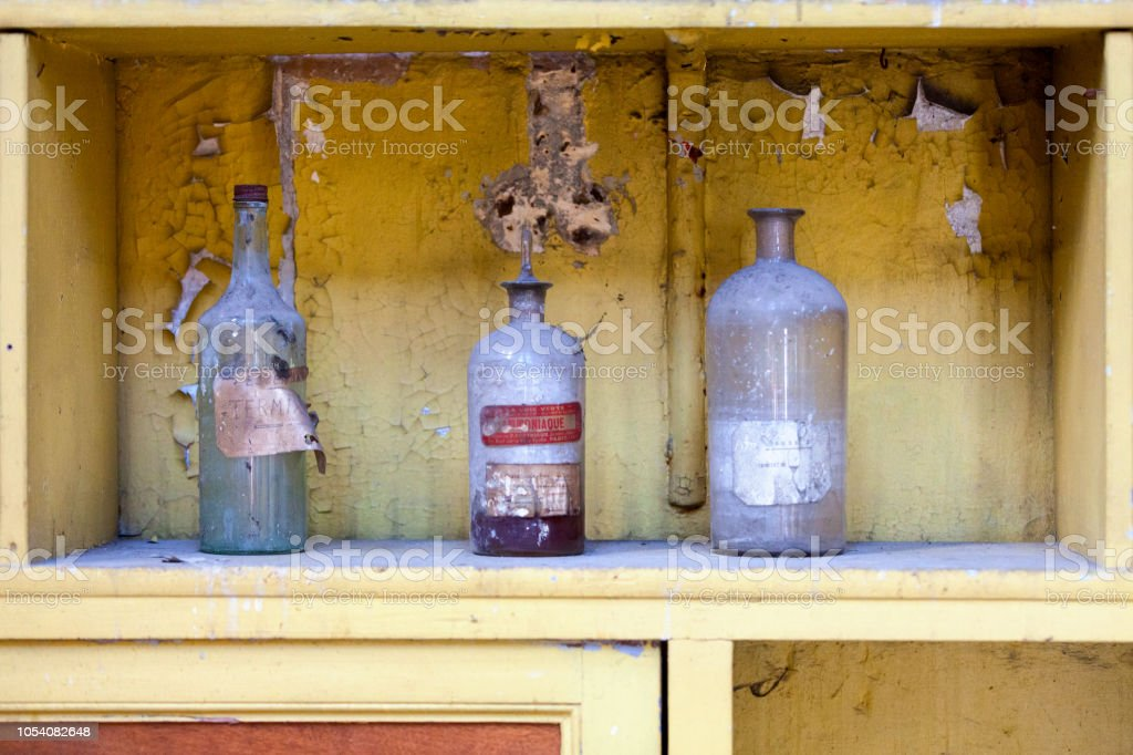 Group of vintage translucent chemical bottles stock photo