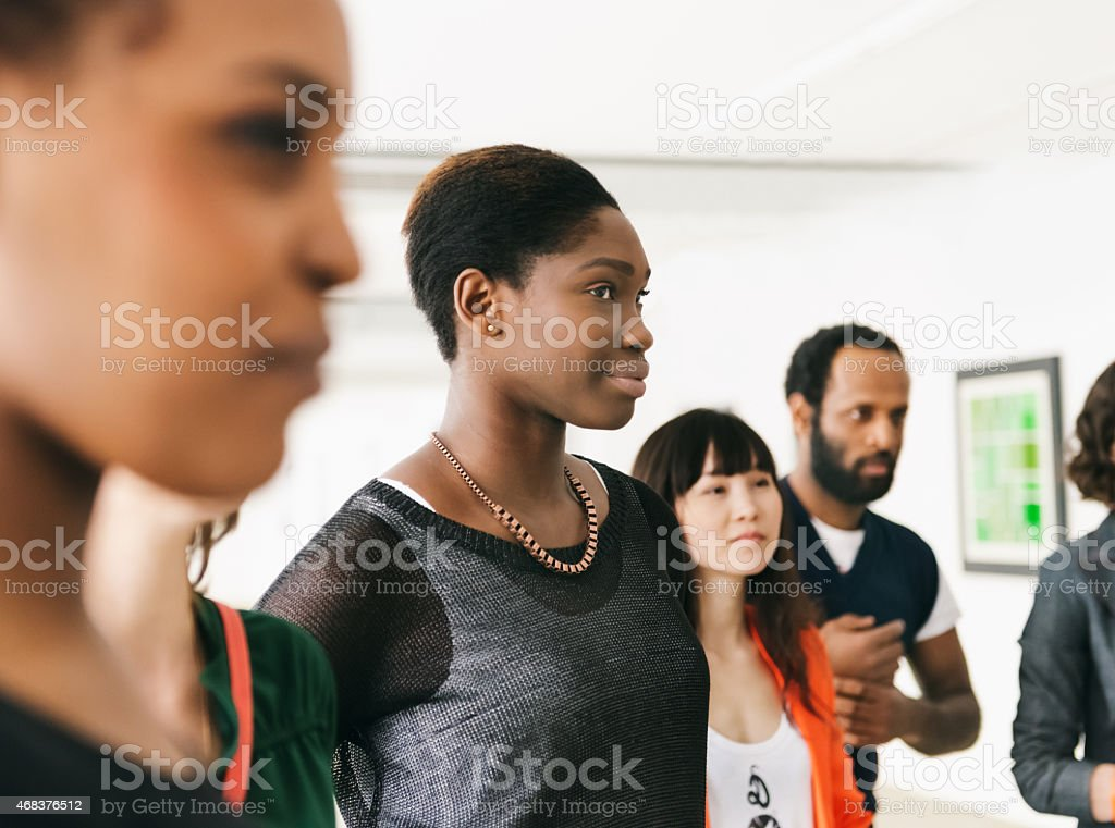 Group Of Visitors During A Gallery Opening stock photo