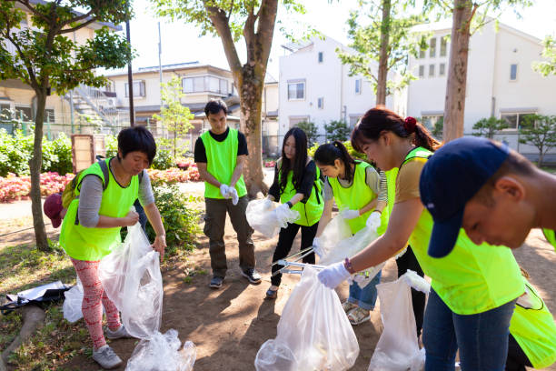 Group of volunteers cleaning public park in Tokyo stock photo