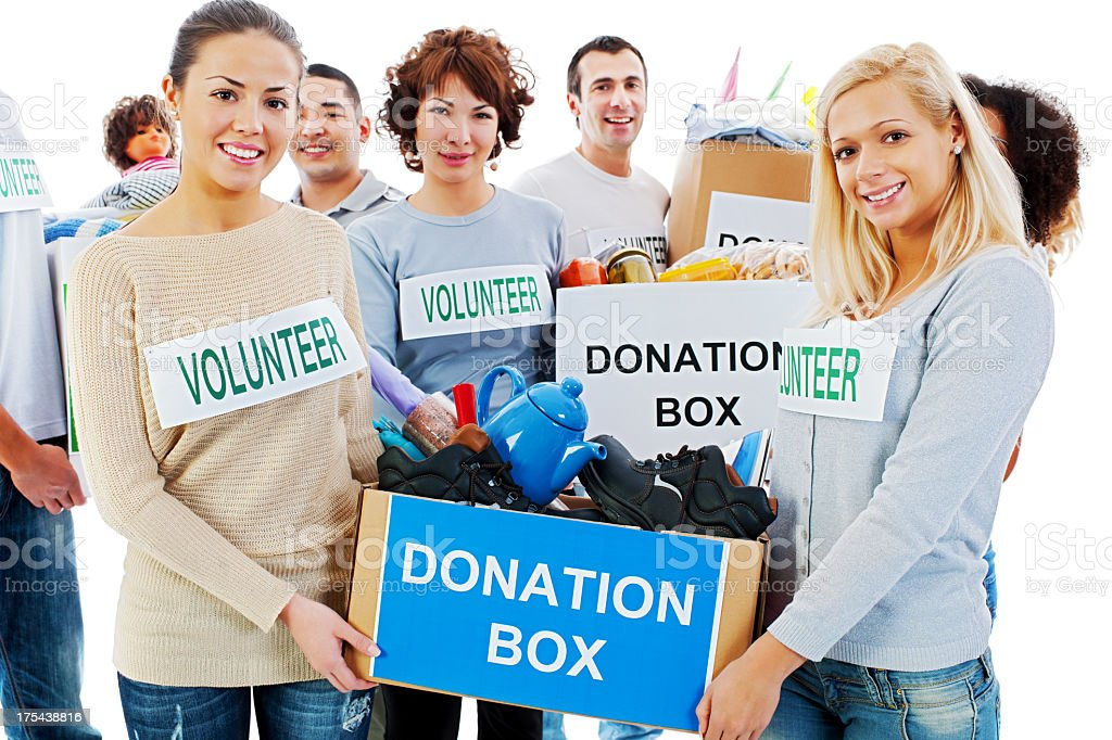 Group of volunteers holding donation boxes. royalty-free stock photo