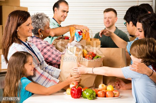 623523102 istock photo Group of volunteers provide groceries donations to needy families. Charity. 477492776