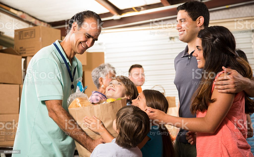 Group of volunteers provide groceries donations to needy families. Charity. stock photo