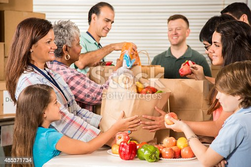 istock Group of volunteers provide groceries donations to needy families. Charity. 485371734