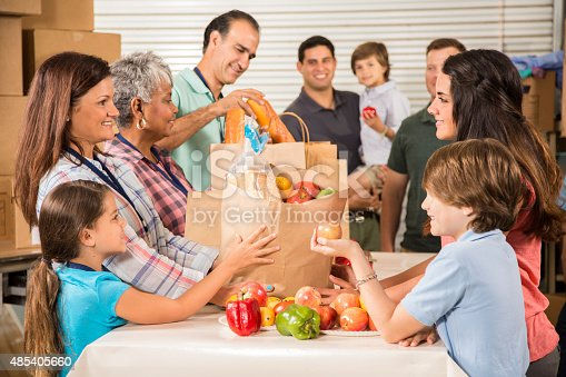 istock Group of volunteers provide groceries donations to needy families. Charity. 485405660