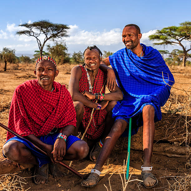group of warriors from maasai tribe, kenya, africa - kenyan culture stock photos and pictures