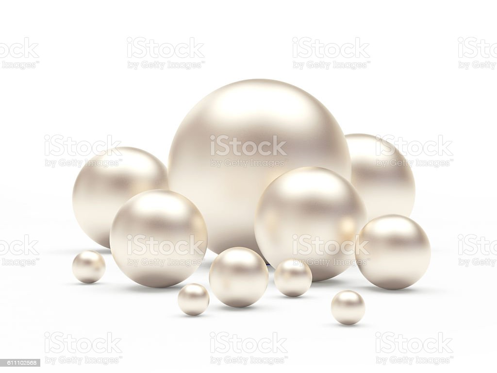 Group of white pearls of different sizes stock photo