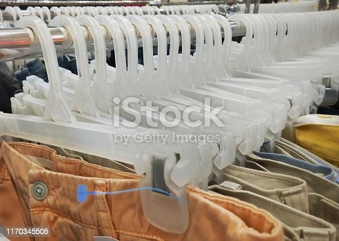 Group of white plastic clothes hangers. Fashion concept image.