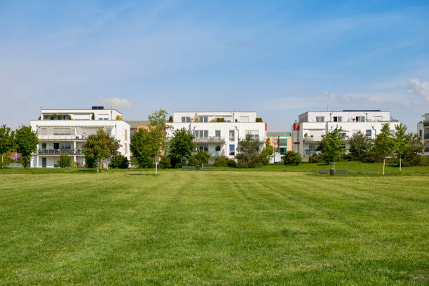 Group of white townhouses and a lawn stock photo