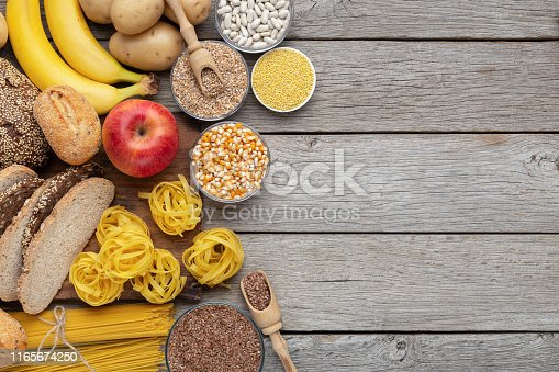Group of wholegrain and carbohydrates food on wooden background, copy space
