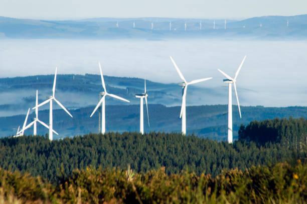 Group of wind turbines, alternative energy, environmental conservation stock photo