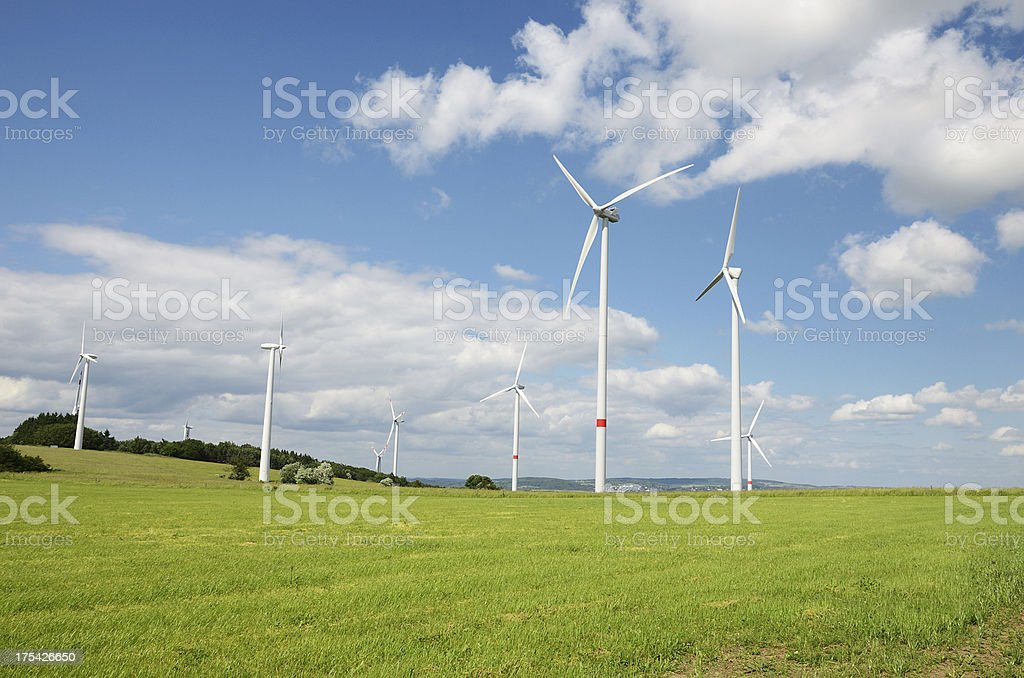 Group of Wind turbines on meadow under clear blue sky royalty-free stock photo