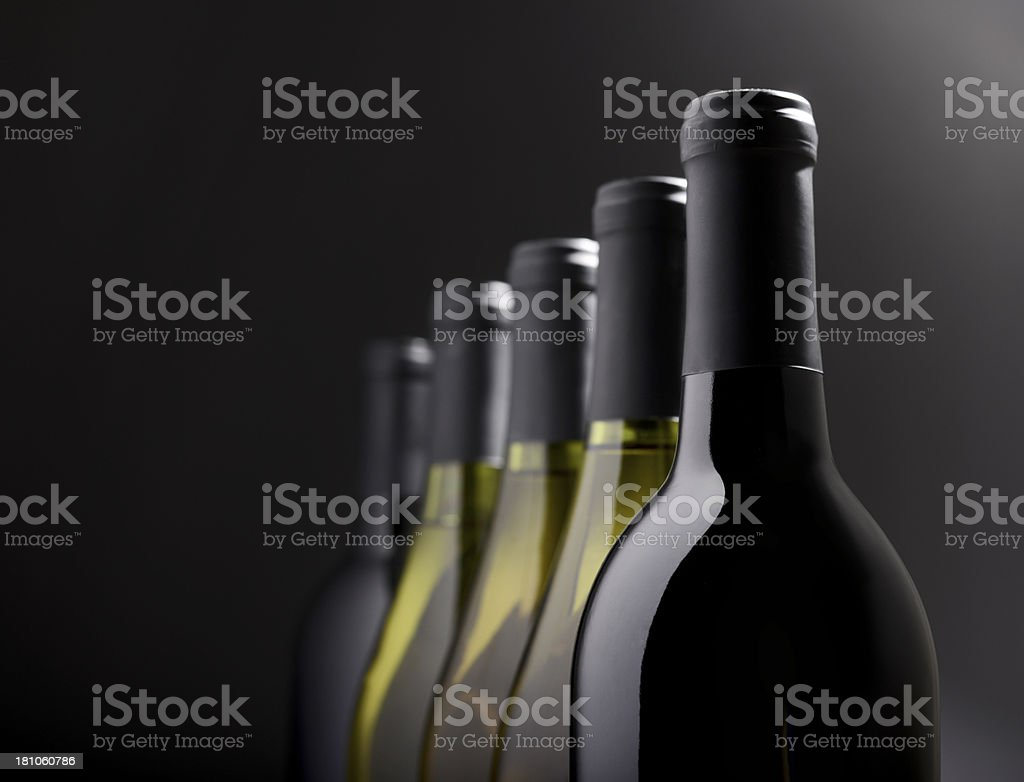 Group of Wine bottles in window light royalty-free stock photo