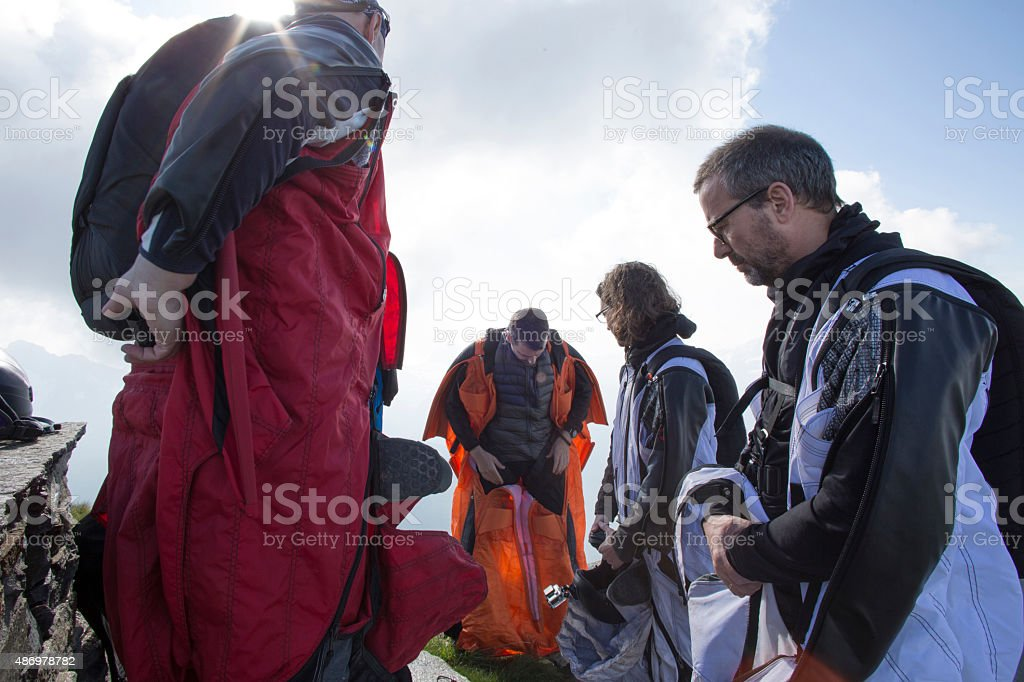 Group of wingsuit jumpers get ready to launch stock photo