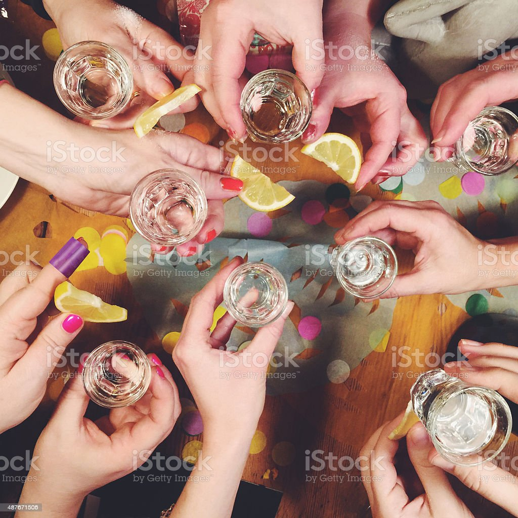 Group of woman drinking tequila shots stock photo