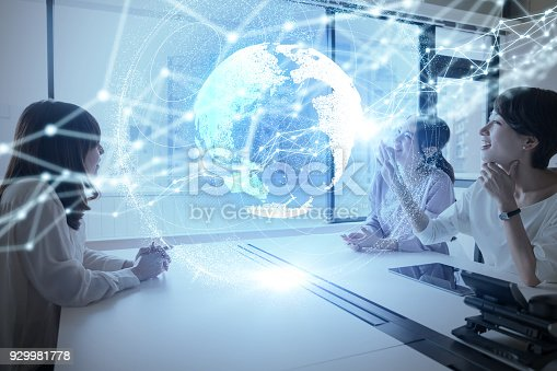 istock Group of woman using holographic interface. 929981778