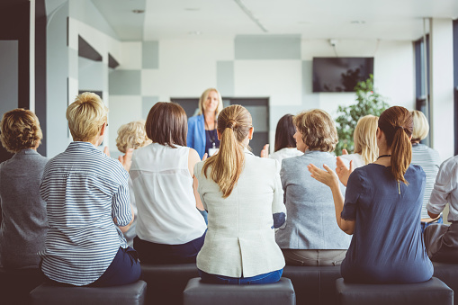 Group Of Women Applauding The Speaker In Seminar Stock Photo - Download Image Now