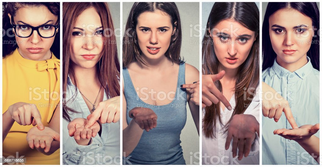 Group of women asking to pay back money stock photo