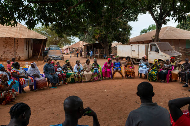 Group of women at a community meeting at the Missira neighborhood in the city of Bissau stock photo