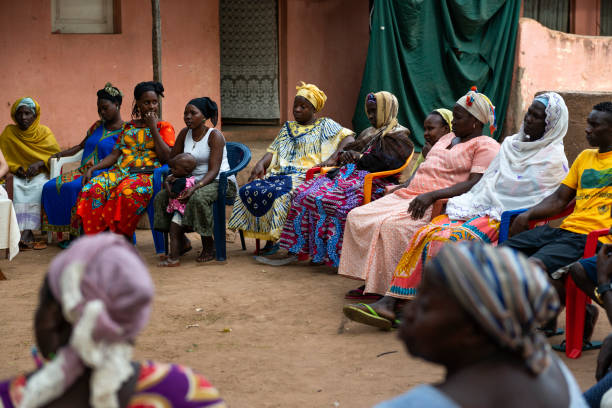 Group of women at a community meeting in the city of Bissau stock photo