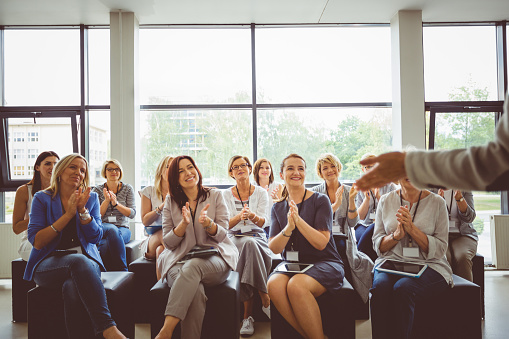 Group Of Women At A Seminar Stock Photo - Download Image Now