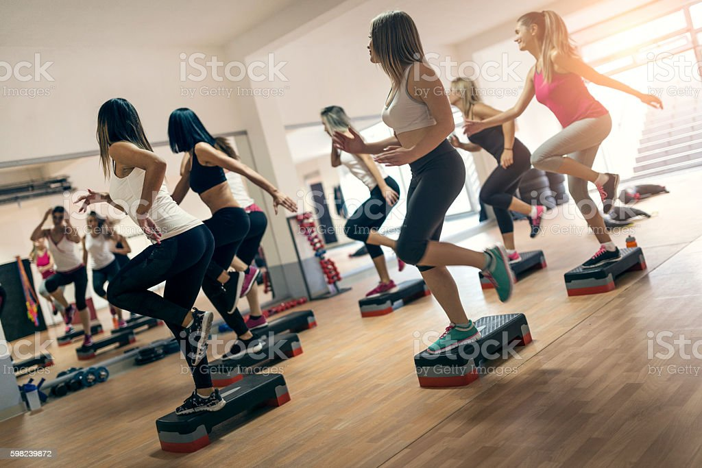 Group of Women at Aerobics Class Exercising In Gym - foto de acervo