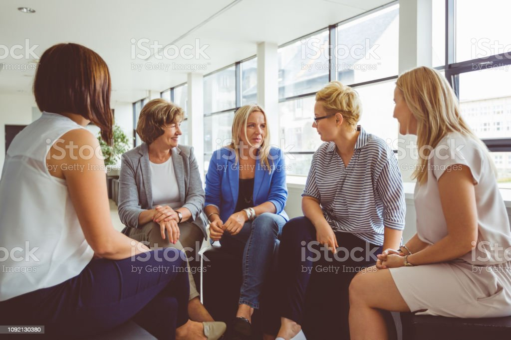 Group of women at the training Female mentor guiding and giving training to a group of women. Group of women at the training in office. Adult Stock Photo