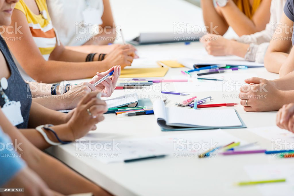 Group of women at the training Group of women attending a training, working together. Close up of hands. Adult Stock Photo