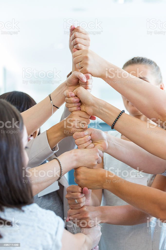Group of women at the training Group of women attending a training, playing together with team building games. Close up of hands. A Helping Hand Stock Photo