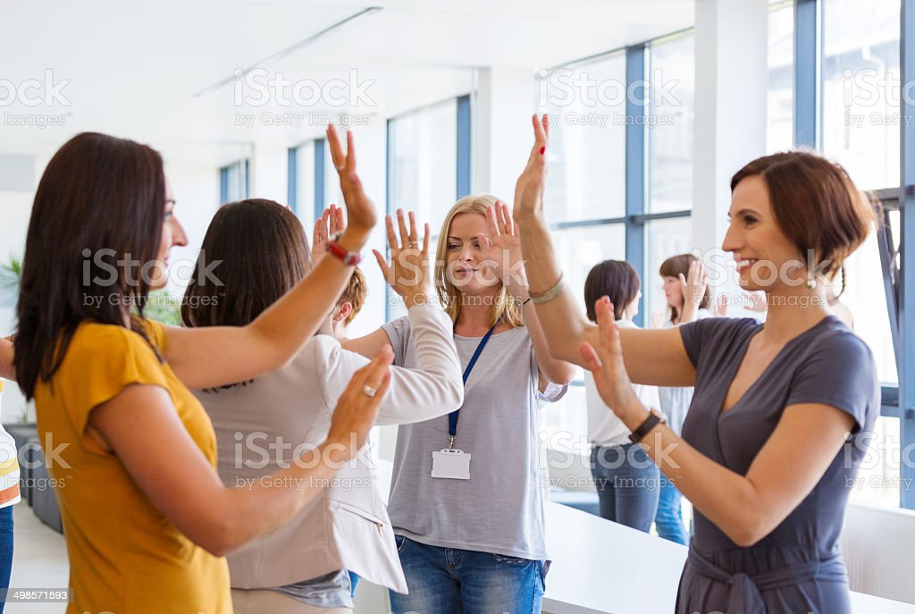 Group of women at the training Group of women attending a training, playing together with hands. 30-39 Years Stock Photo