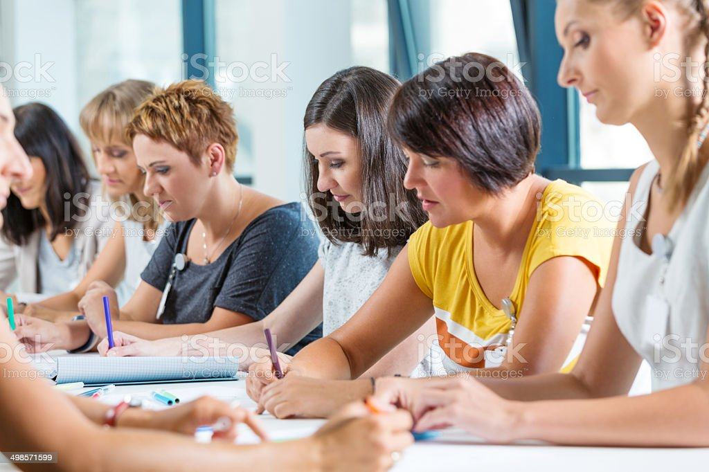 Group of women at the training Group of women attending a training, working together. 30-39 Years Stock Photo