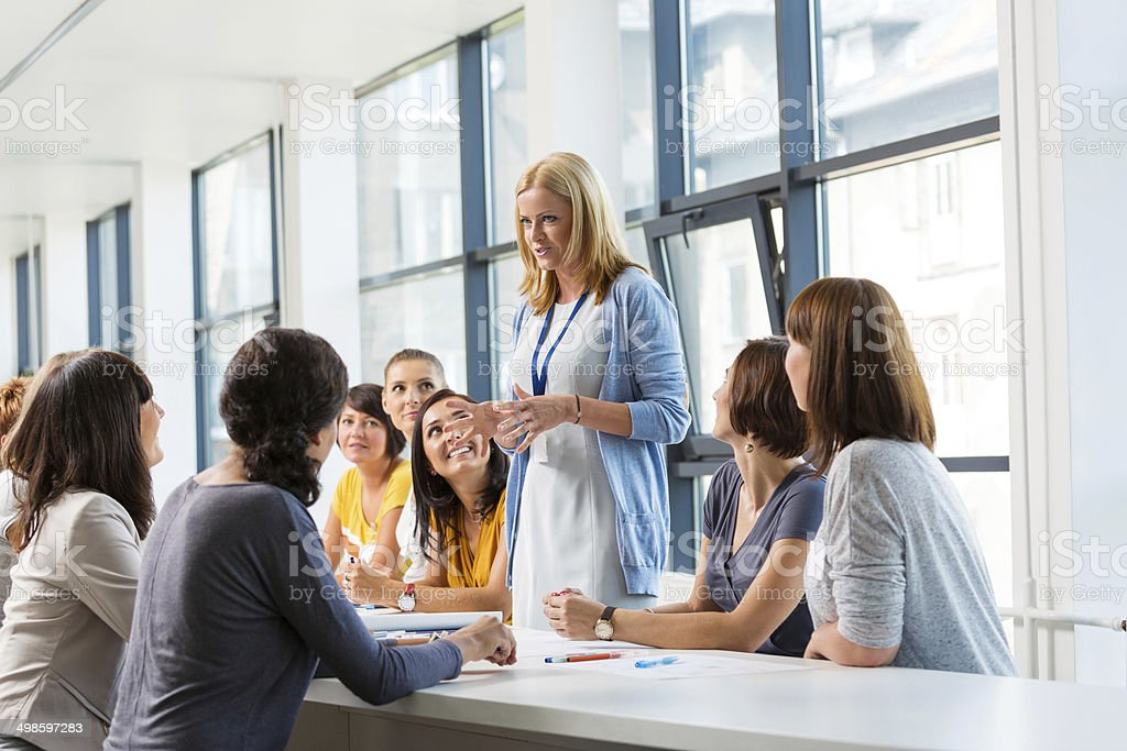 Group of women at the training Group of smiling women attending a training, working together and discussing. 30-39 Years Stock Photo
